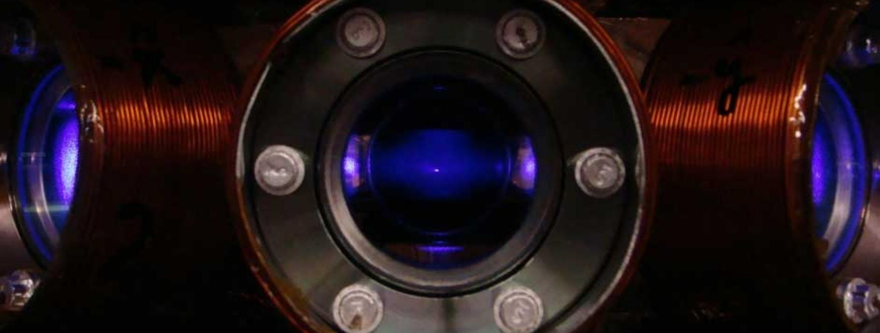 Ultracold dysprosium atoms fluorescing blue light inside an ultrahigh vacuum chamber